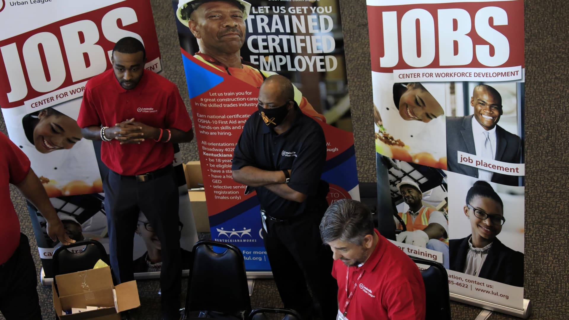 Employees from the Louisville Urban League speak with job seekers at a Job News USA career fair in Louisville, Kentucky, U.S., on Wednesday, June 23, 2021.
