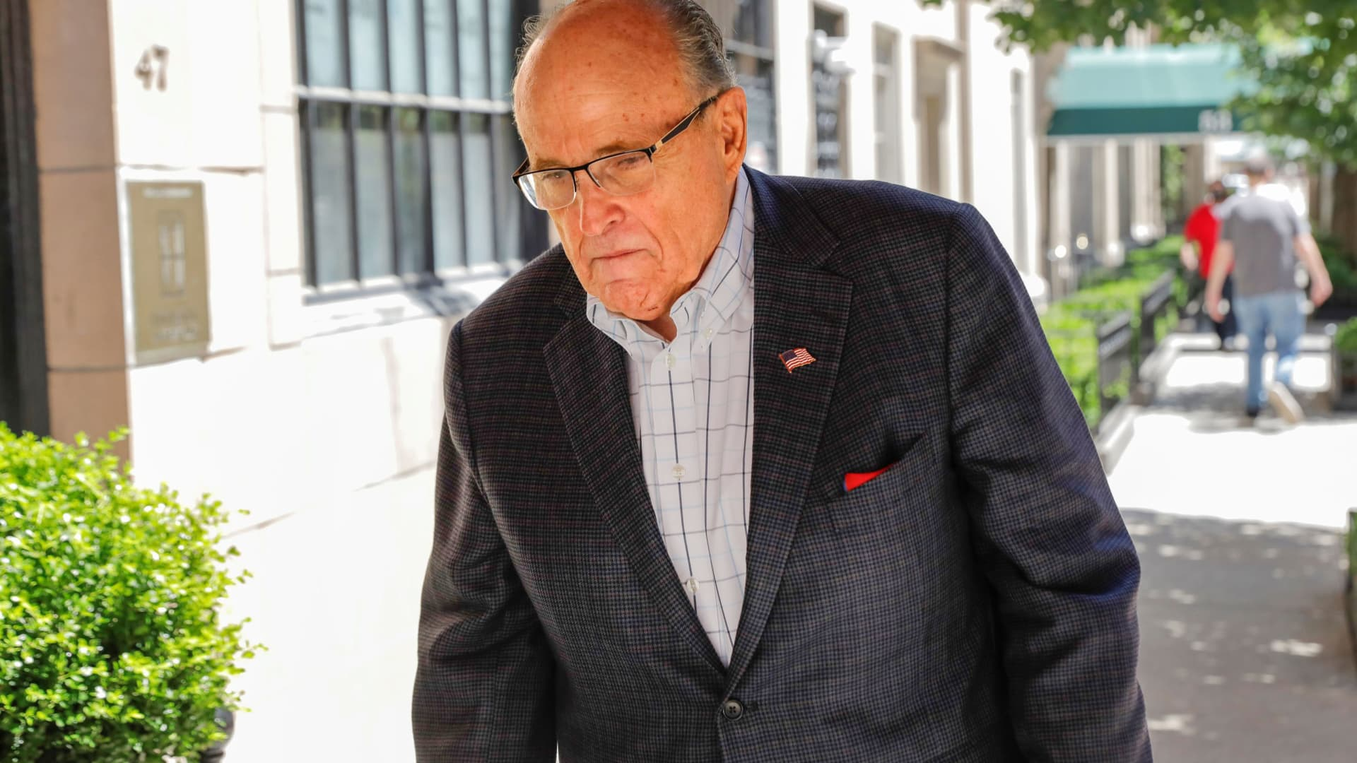 Former New York City Mayor Rudy Giuliani arrives at his apartment building after the suspension of his law license in Manhattan in New York City, New York, June 24, 2021.
