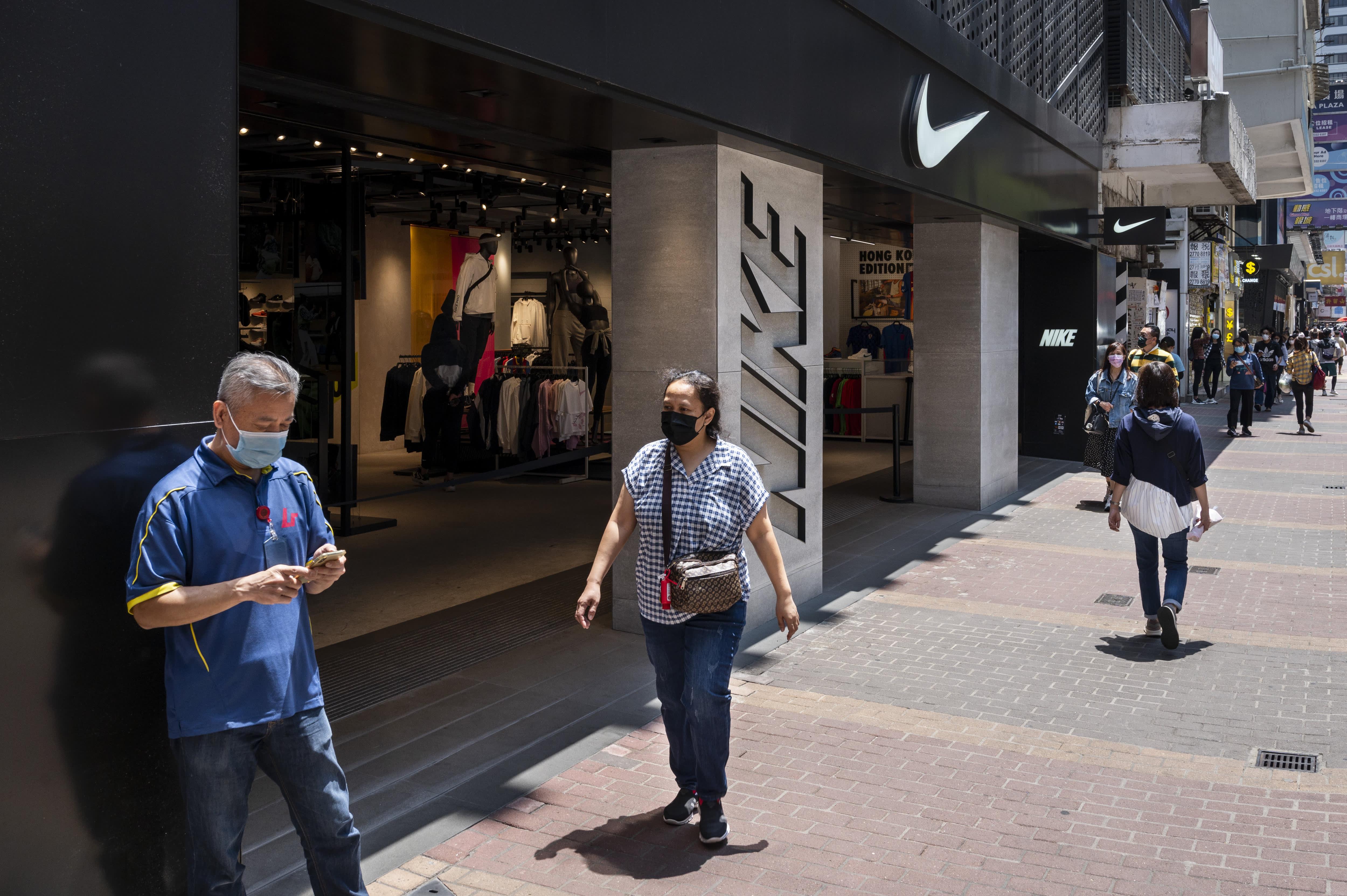 Nike shares fall as supply chain havoc leads retailer to slash revenue forecast