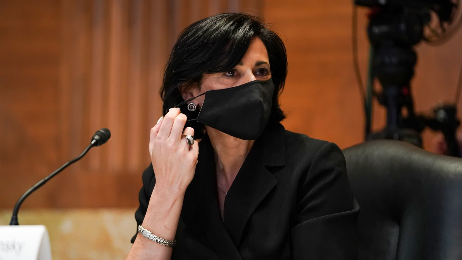 Rochelle Walensky, director of the U.S. Centers for Disease Control and Prevention (CDC), takes off a protective mask during a Senate Appropriations Subcommittee hearing in Washington, D.C., U.S., on Wednesday, May 19, 2021.