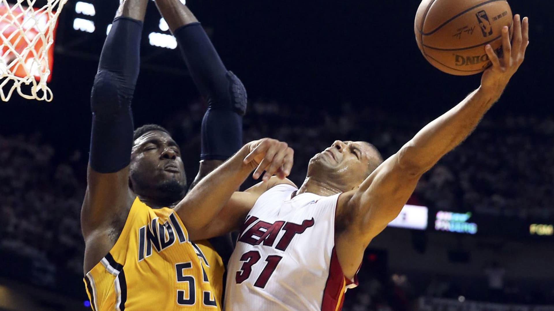 The Miami Heat's Shane Battier (31) can't get around the Indiana Pacers' Roy Hibbert at the basket in the first quarter in Game 3 of the Eastern Conference Finals at AmericanAirlines Arena in Miami on Saturday, May 24, 2014.