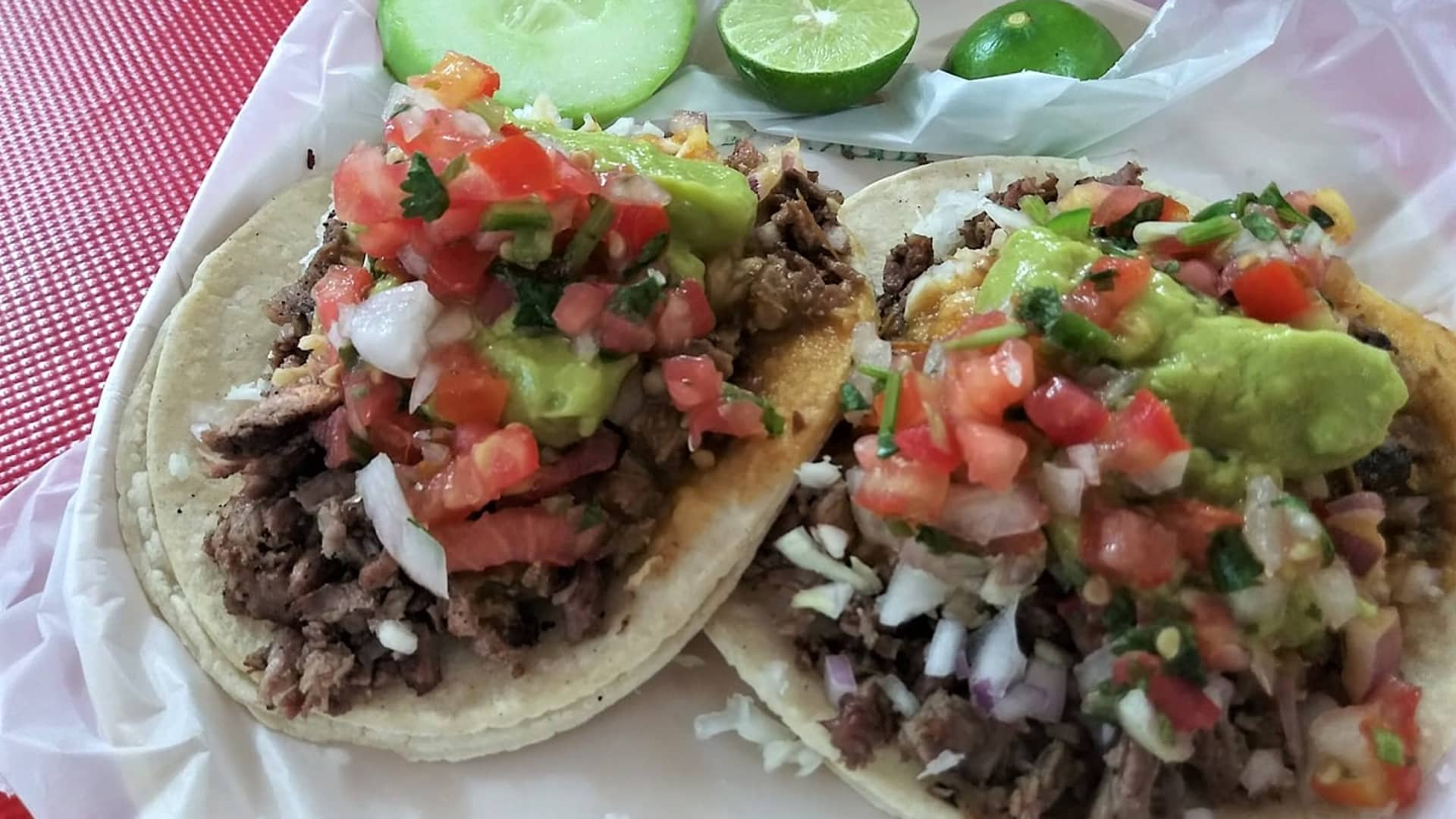 Classic carne asada tacos on fresh-made corn tortillas with all the fixings—what's not to love?!