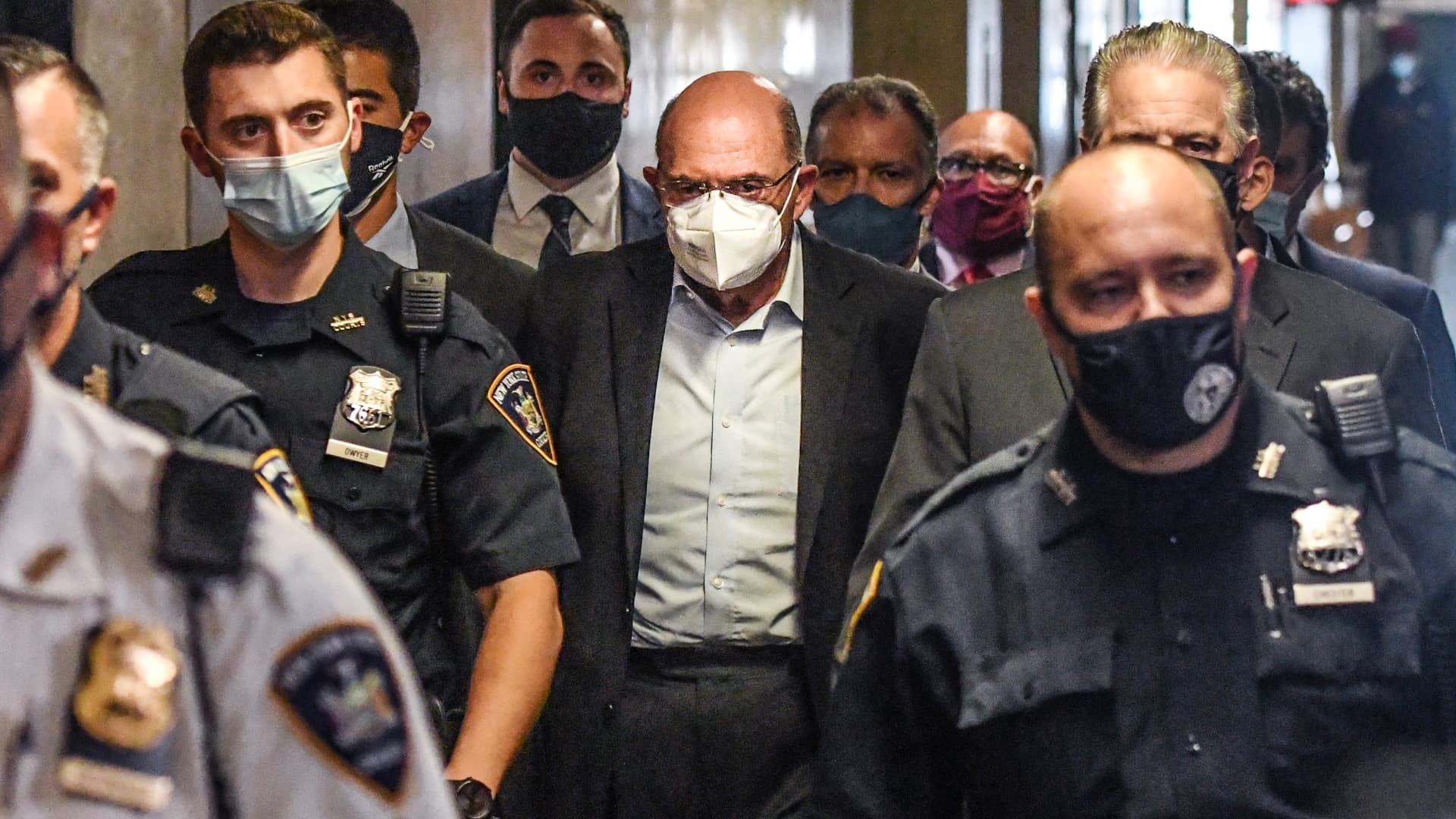 Allen Weisselberg, chief financial officer of Trump Organization Inc., center, walks towards a courtroom at criminal court in New York, U.S., on Thursday, July 1, 2021.