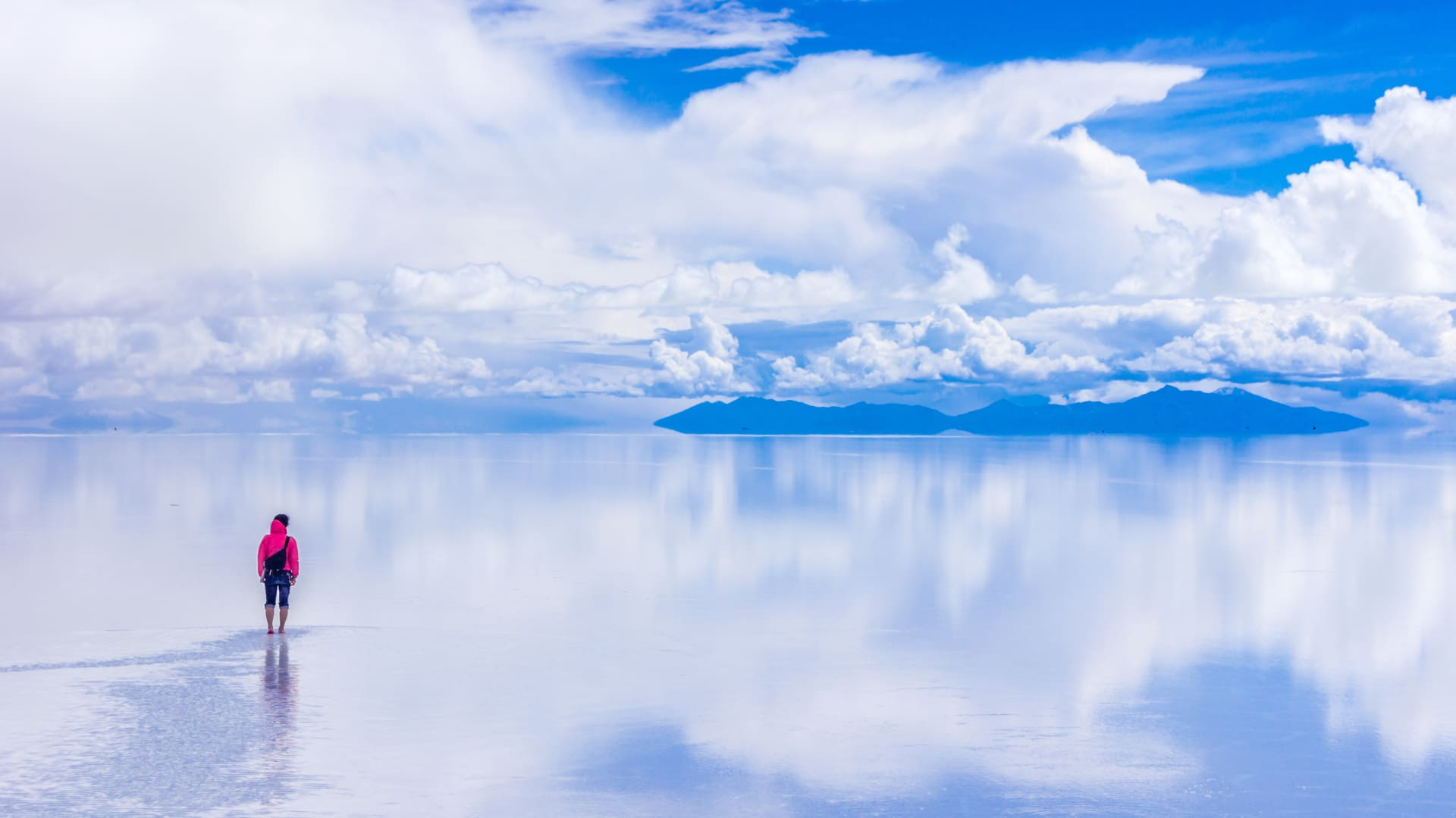 Rain causes Bolivia's Uyuni salt flats to take on a still mirror-like quality.