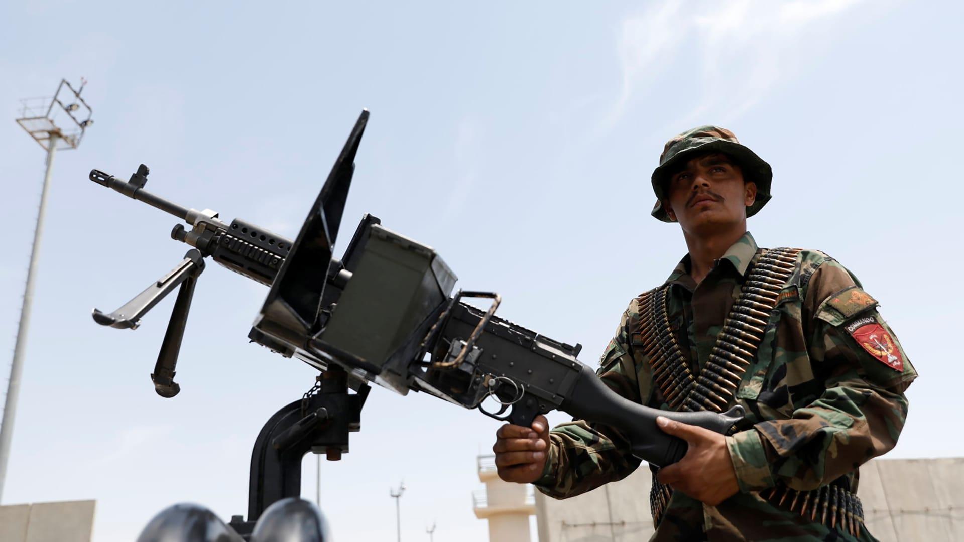 An Afghan security forces member keeps watch in an army vehicle in Bagram U.S. air base, after American troops vacated it, in Parwan province, Afghanistan July 5, 2021.