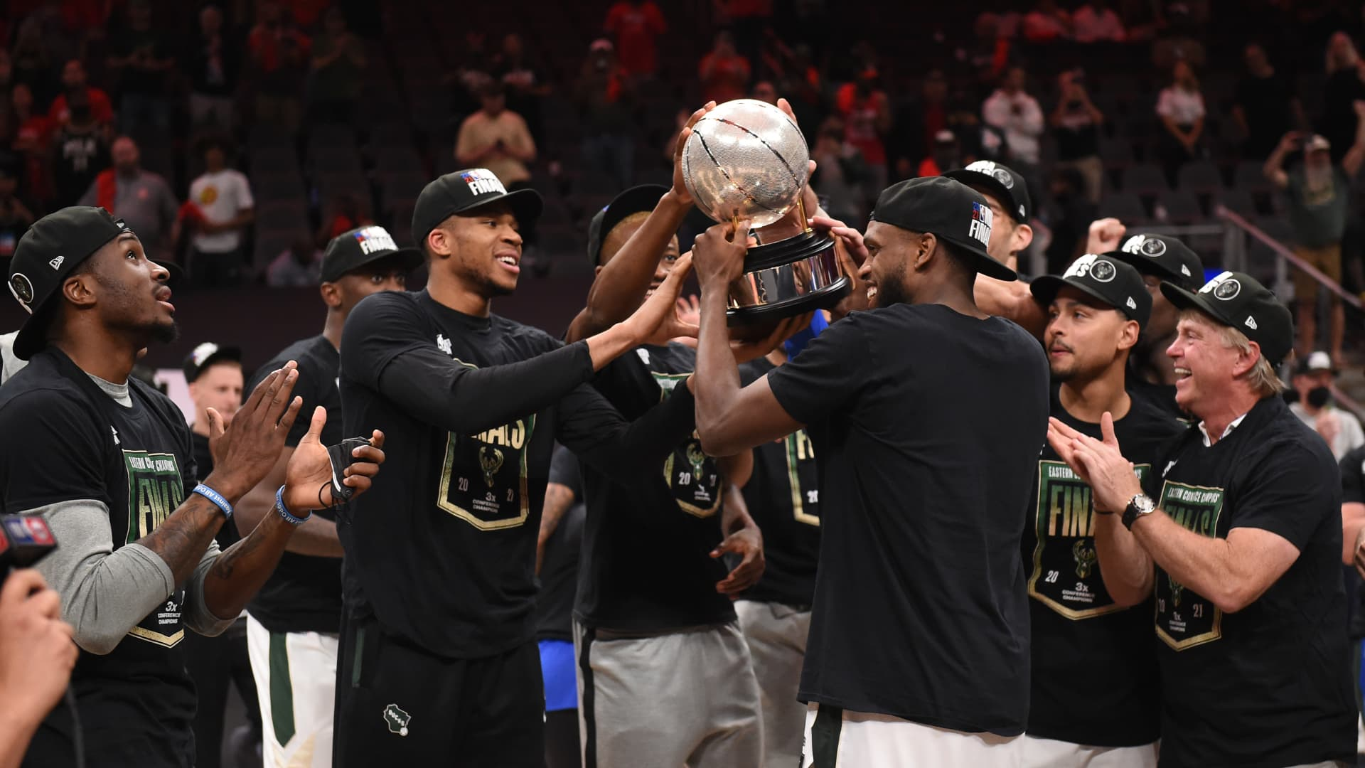 Khris Middleton #22 of the Milwaukee Bucks holds up the Eastern Conference Finals Trophy after the game against the Atlanta Hawks during Game 6 of the Eastern Conference Finals of the 2021 NBA Playoffs on July 3, 2021 at State Farm Arena in Atlanta, Georgia.