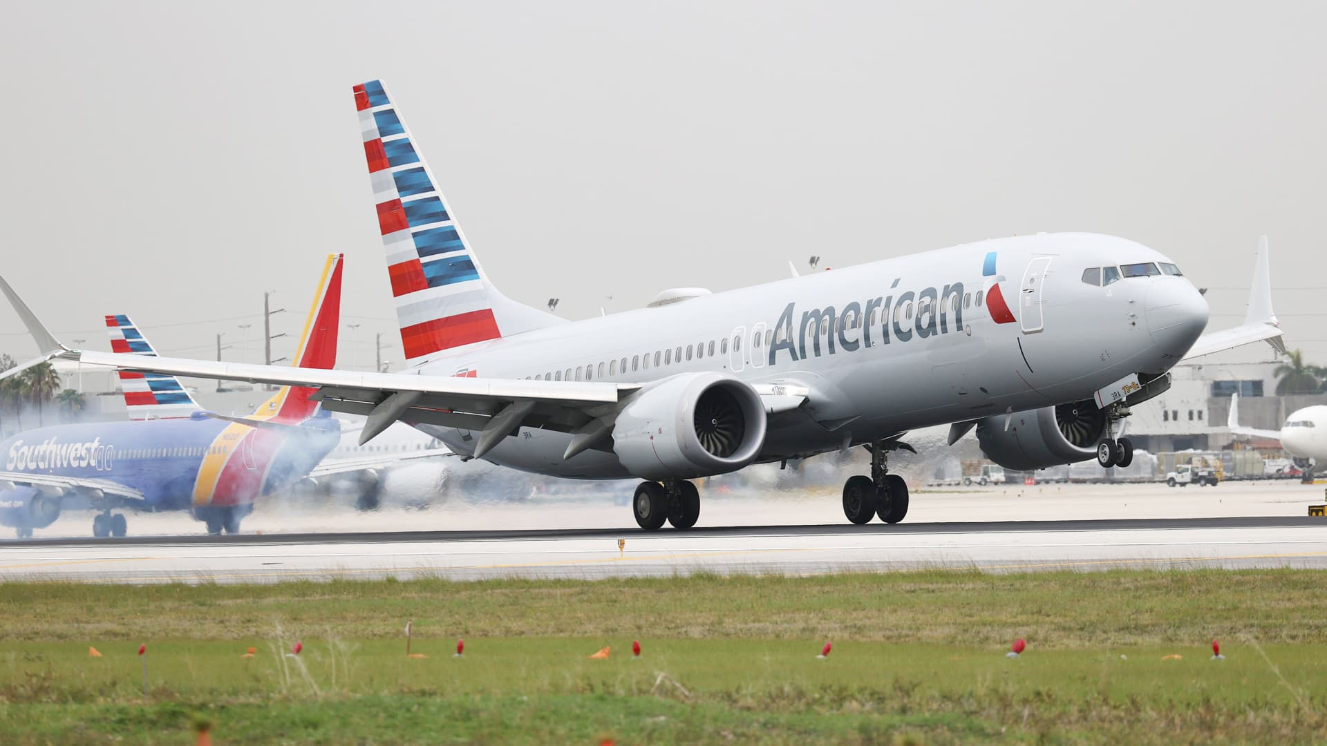 An American Airlines plane lands at the Miami International Airport on June 16, 2021 in Miami, Florida.