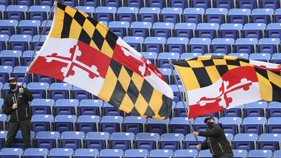 Baltimore Ravens employees wave Maryland flags in the stands at M&T Bank Stadium on November 01, 2020 in Baltimore, Maryland.