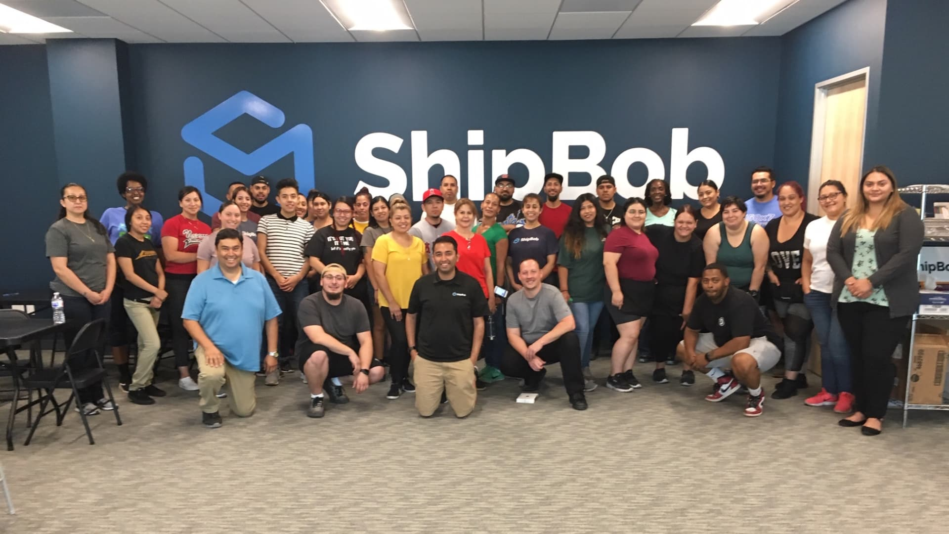 ShipBob employees with CEO Dhruv Saxena in middle