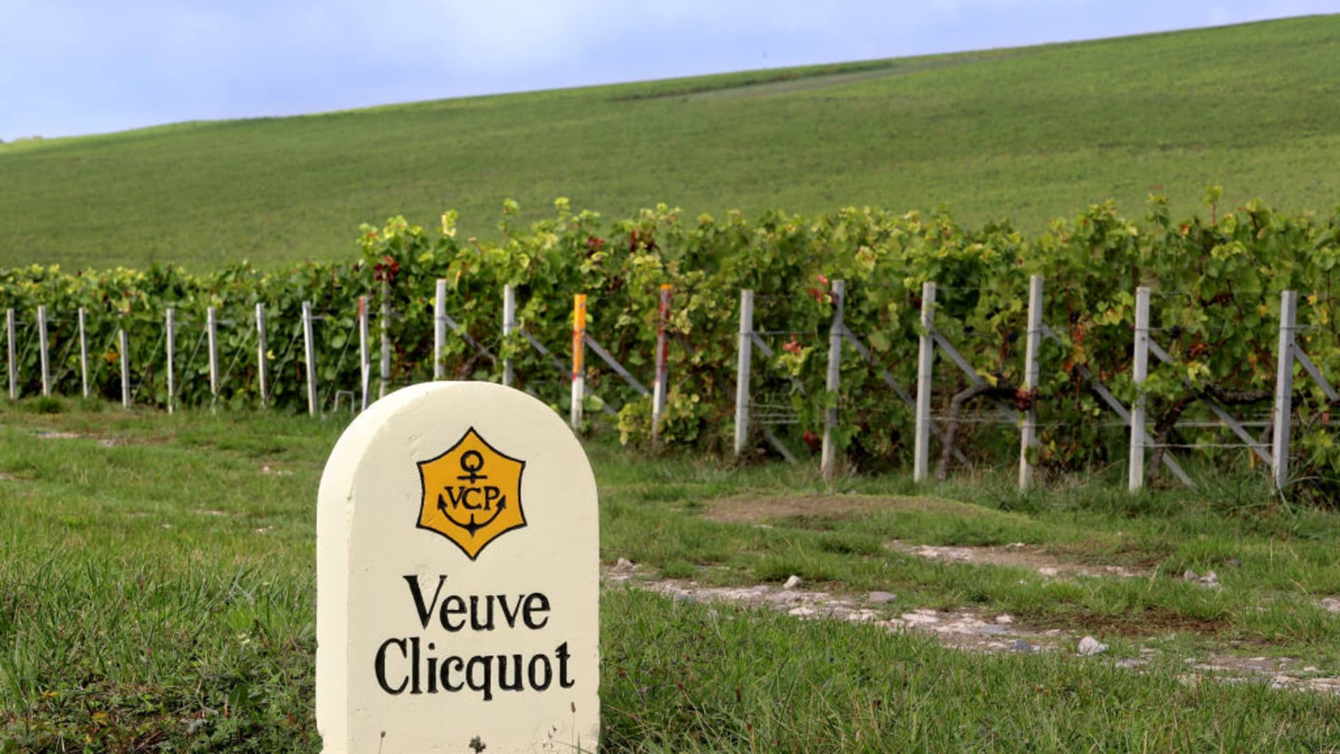 A stone marker indicates the vineyards belong to Champagne Veuve Clicquot in the village of Ay in the Vallée de la Marne champagne production region of eastern France.