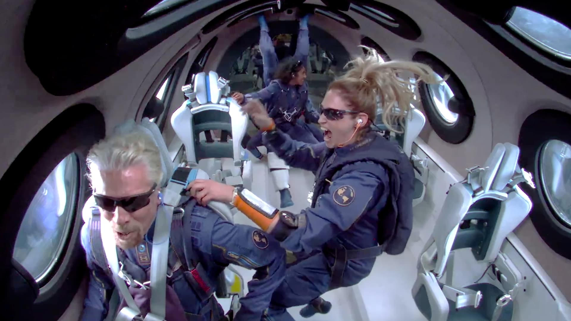 Billionaire Richard Branson makes a statement as crew members Beth Moses and Sirisha Bandla float in zero gravity on board Virgin Galactic's passenger rocket plane VSS Unity after reaching the edge of space above Spaceport America near Truth or Consequences, New Mexico, U.S. July 11, 2021 in a still image from video.
