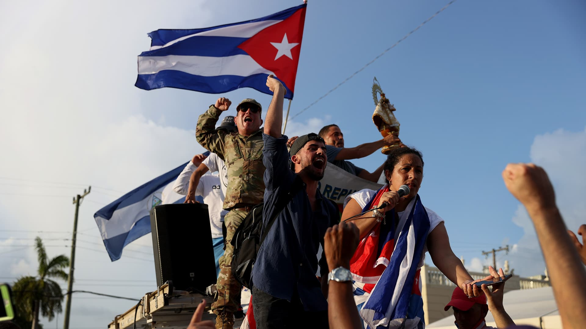 Protesters gather in front of the Versailles restaurant to show support for the people in Cuba who have taken to the streets there to protest on July 11, 2021 in Miami, Florida.