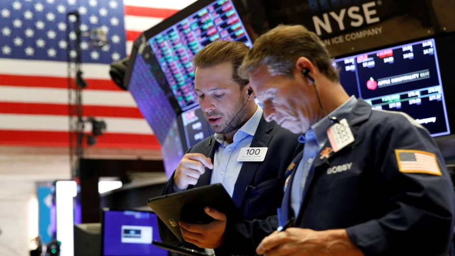 Traders work on the floor of the New York Stock Exchange (NYSE) in New York City, U.S., July 12, 2021.
