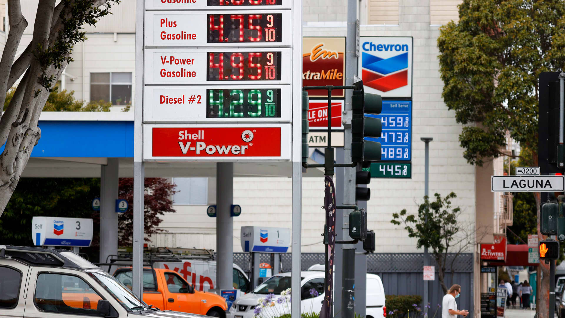 Gas prices nearing $5.00 a gallon are displayed at Chevron and Shell stations on July 12, 2021 in San Francisco, California.