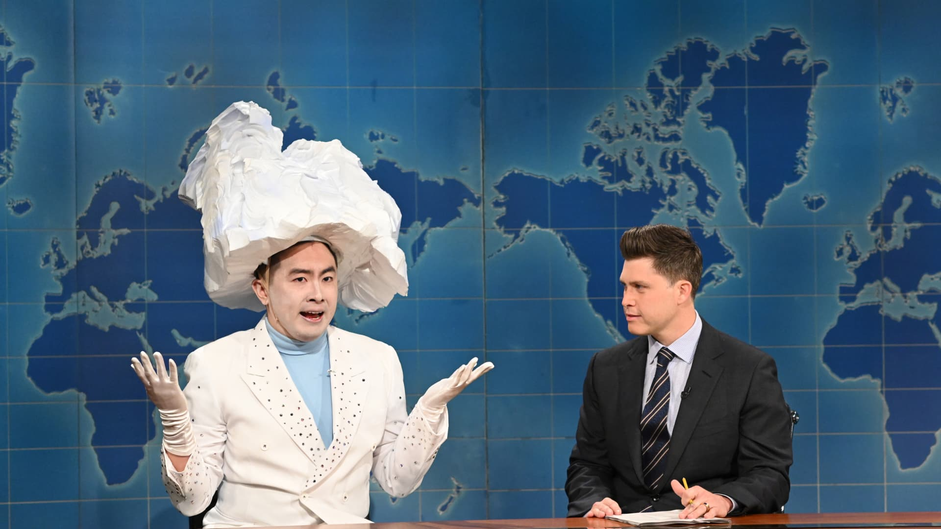 Pictured: (l-r) Bowen Yang as 'The Iceberg That Sank The Titanic' and anchor Colin Jost during Weekend Update on Saturday, April 10, 2021.