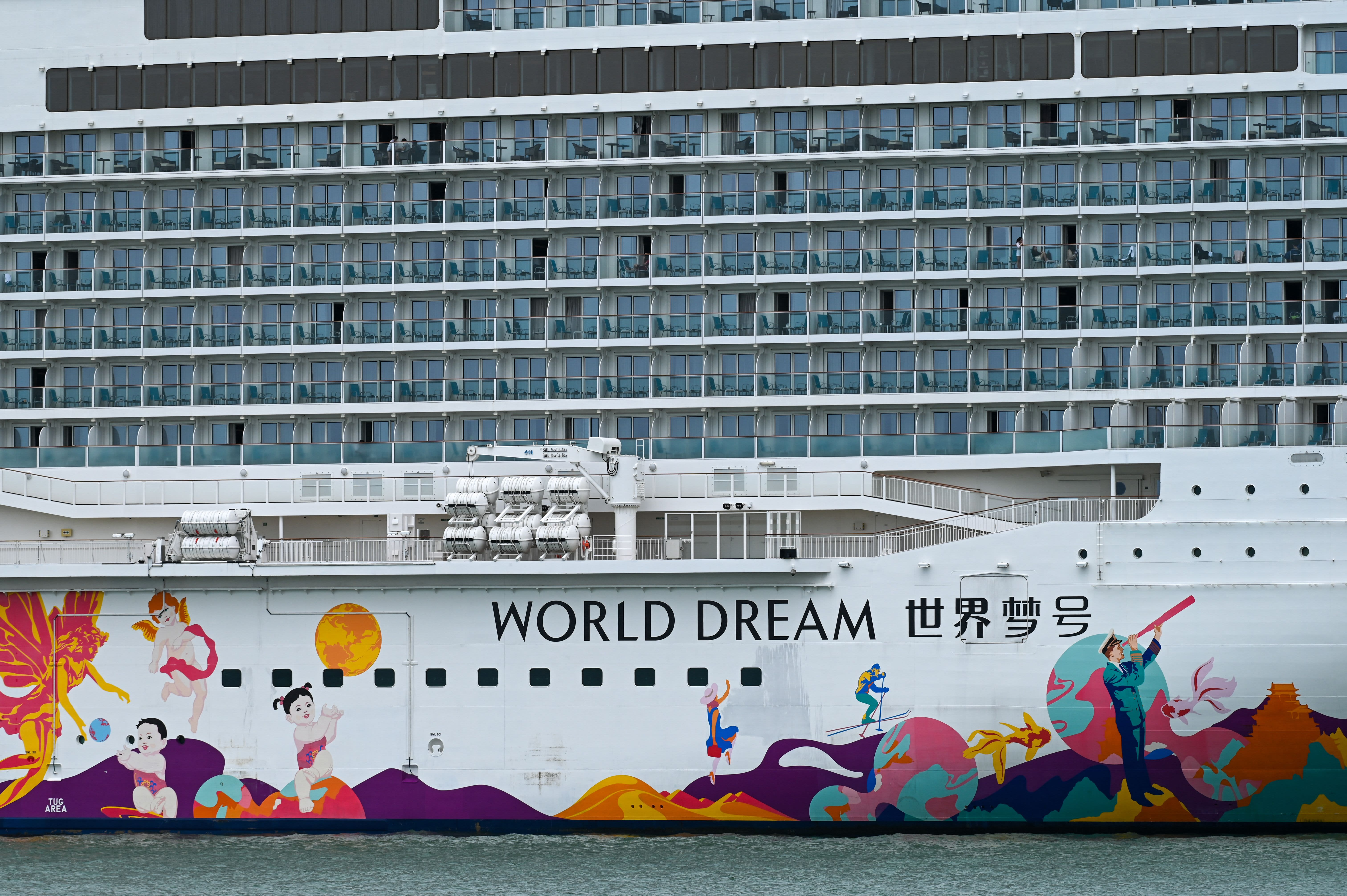 Nearly 3,000 guests, crew disembark cruise in Singapore after positive Covid case left them confined in cabins