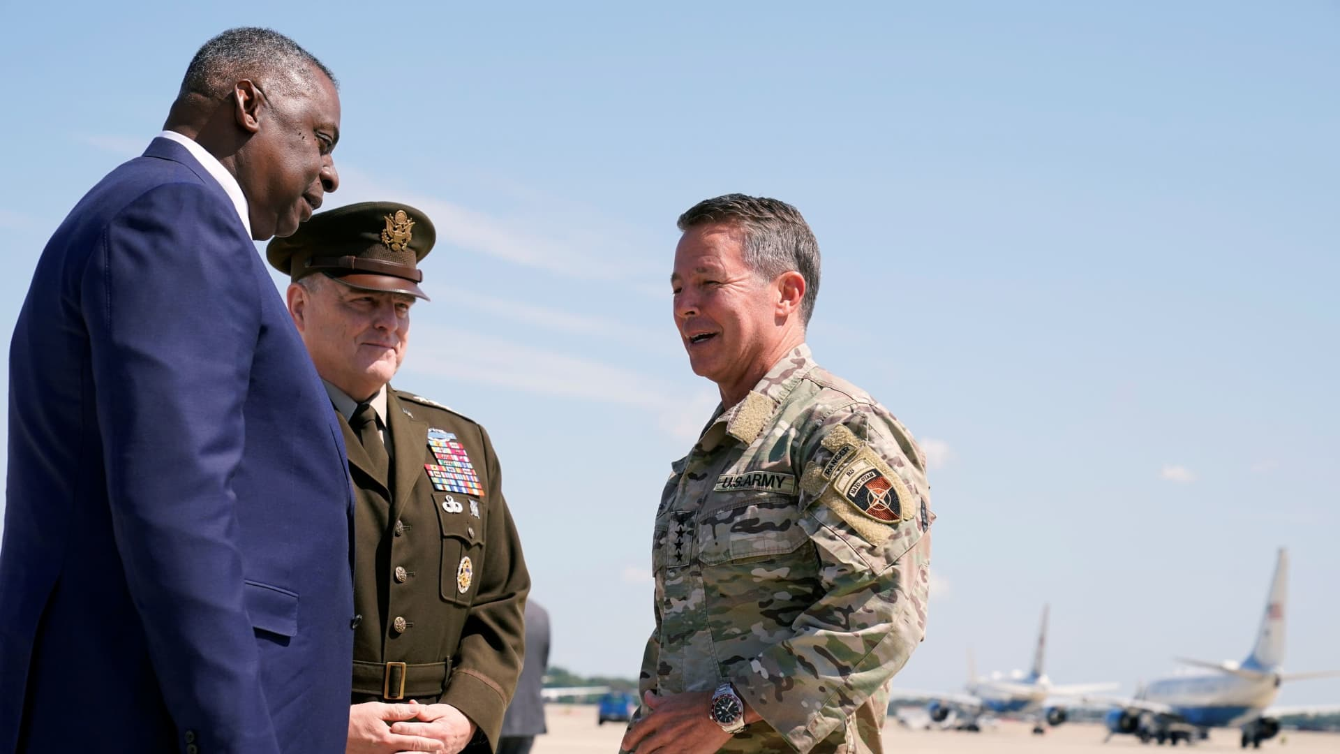 U.S. Secretary of Defense Lloyd Austin, left, and Joint Chiefs of Staff General Mark Milley greet General Austin S. Miller, the former top U.S. commander in Afghanistan, upon his return, at Andrews Air Force Base, U.S. July 14, 2021.