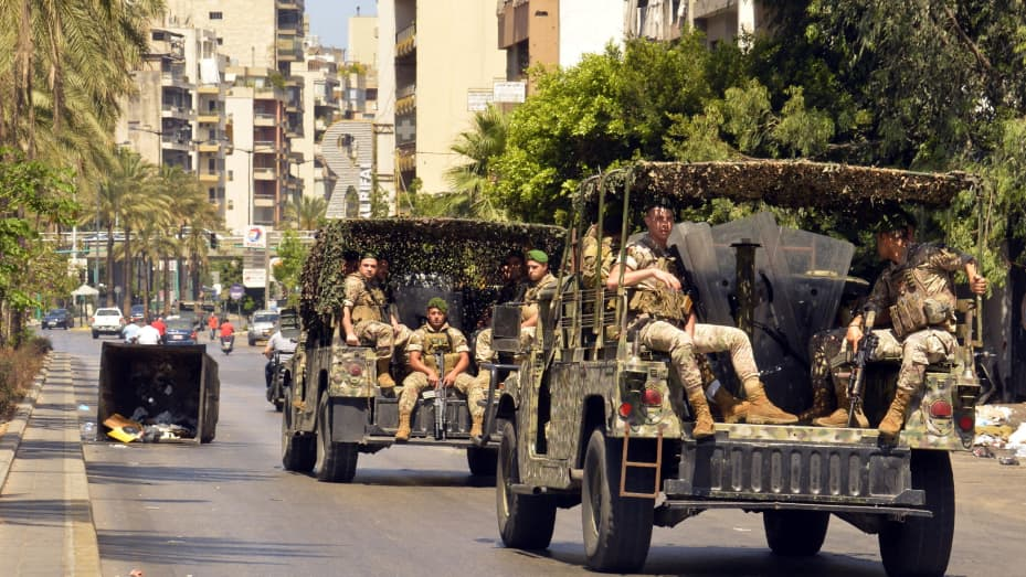 """Soldiers patrol streets as protesters block roads during a protest demanding """"recovery government."""""""