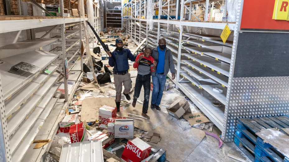 South African Police Services (SAPS) members arrest a looter at the Gold Spot Shopping Centre in Vosloorus, southeast of Johannesburg, on July 12, 2021.