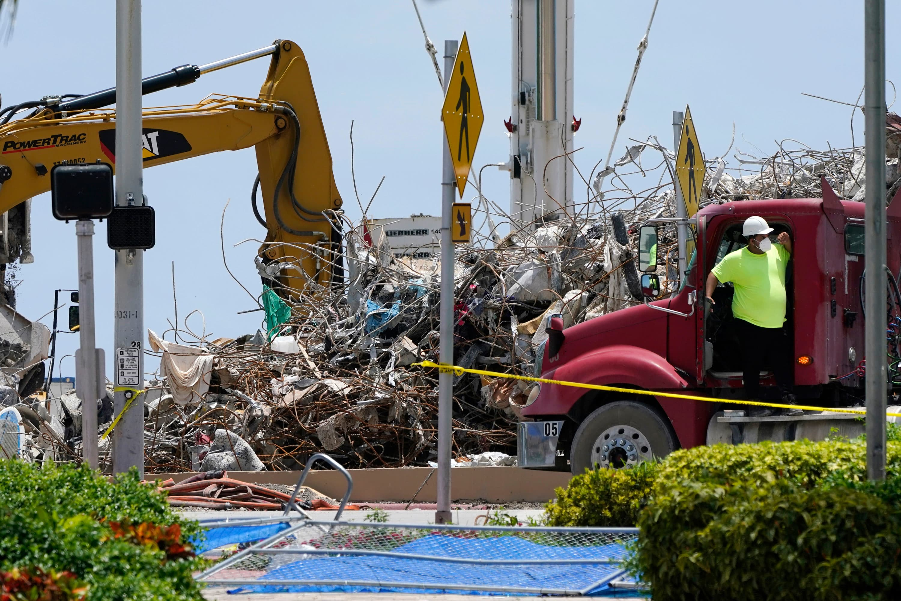 Death toll rises to 97 in Surfside condo collapse; judge approves sale of site