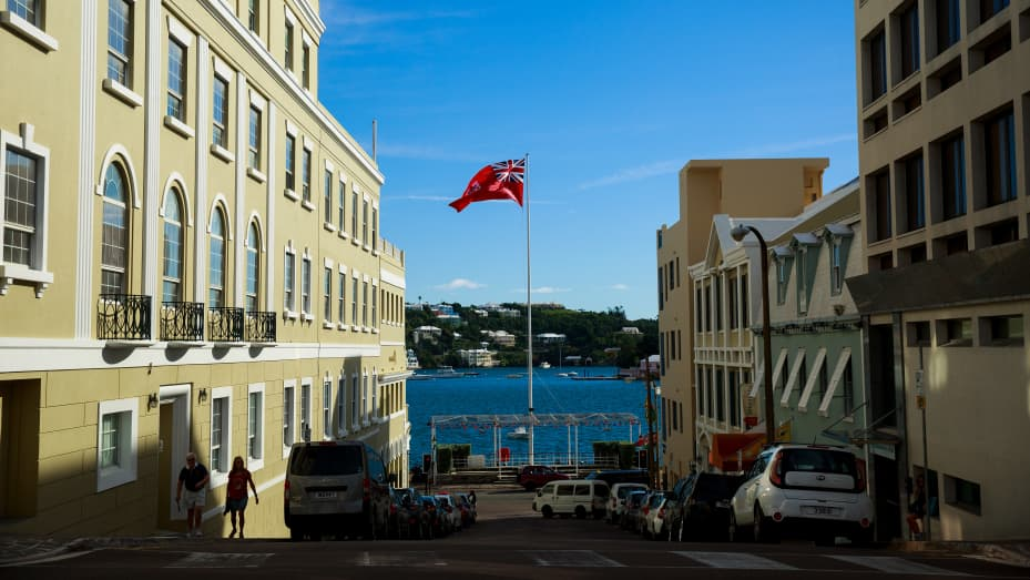 The flag of Bermuda flies in the city of Hamilton, Bermuda, November 8, 2017. In series of leaks made public by the International Consortium of Investigative Journalists, the Paradise Papers shed light on the trillions of dollars that move through offshore tax havens.