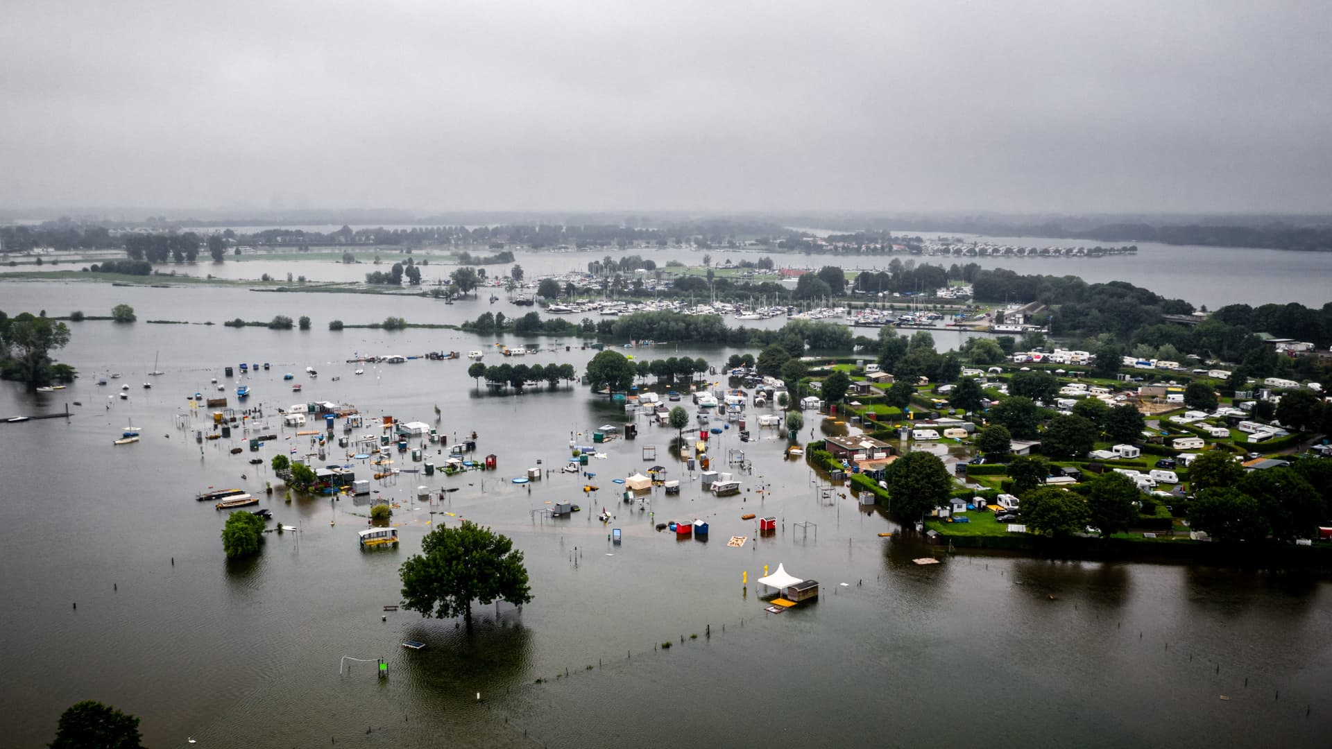 This aerial photograph shows partially submerged caravans and campers in flood waters at the camping site of De Hatenboer in Roermond on July 15, 2021.