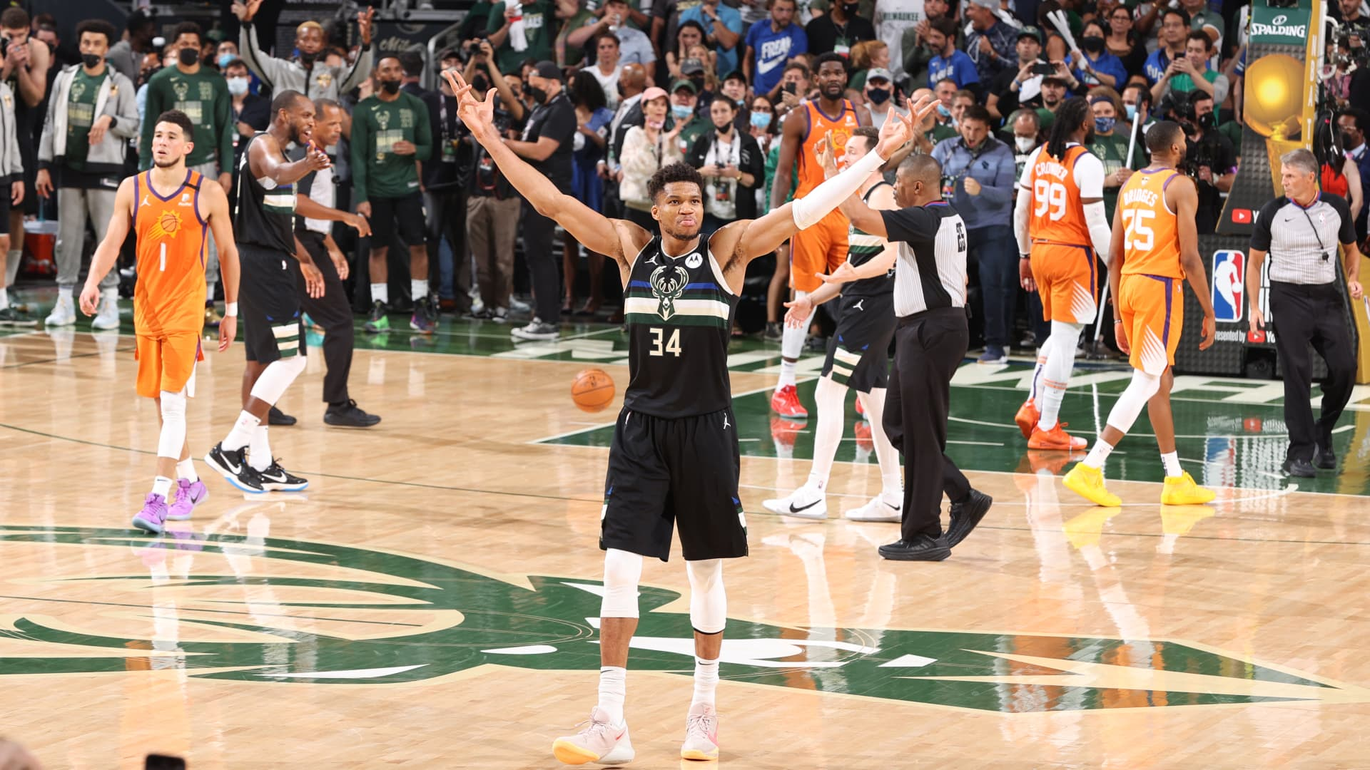 Giannis Antetokounmpo #34 of the Milwaukee Bucks celebrates during Game Six of the 2021 NBA Finals on July 20, 2021 at the Fiserv Forum in Milwaukee, Wisconsin. Copyright 2021 NBAE.