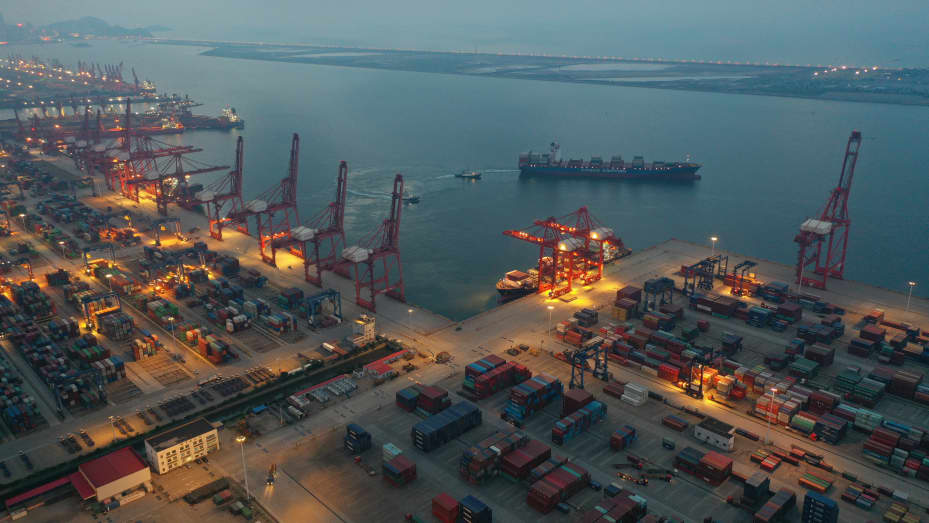 A ship leaves a container port in the evening in Lianyungang in east China's Jiangsu province Thursday, July 22, 2021.