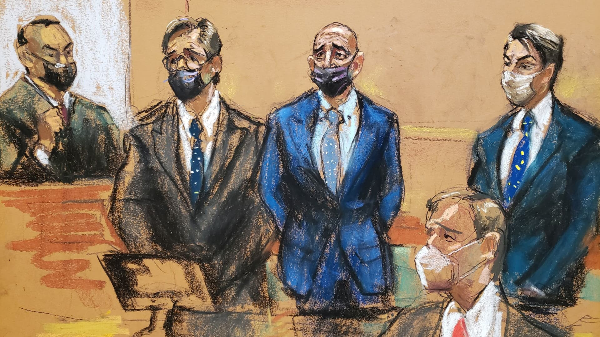 Thomas Barrack, a billionaire friend of Donald Trump who chaired the former president's inaugural fund, stands beside his co-defendant and former employee Matthew Grimes and his lawyer Matt Herrington during their arraignment hearing at the Brooklyn Federal Courthouse in Brooklyn, New York, U.S., July 26, 2021 in this courtroom sketch.