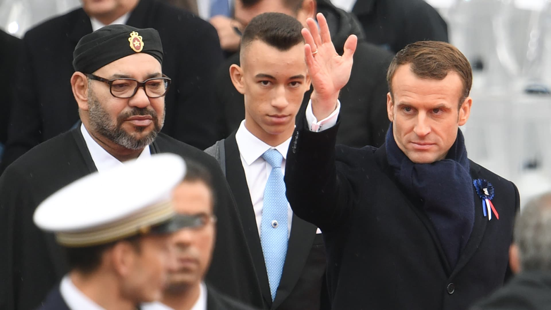 PARIS - French President Emmanuel Macron (R) waves as he leaves with Morocco's Prince Moulay Hassan (C) nd Moroccan King Mohammed VI (L) after attending a ceremony at the Arc de Triomphe in Paris on November 11, 2018.