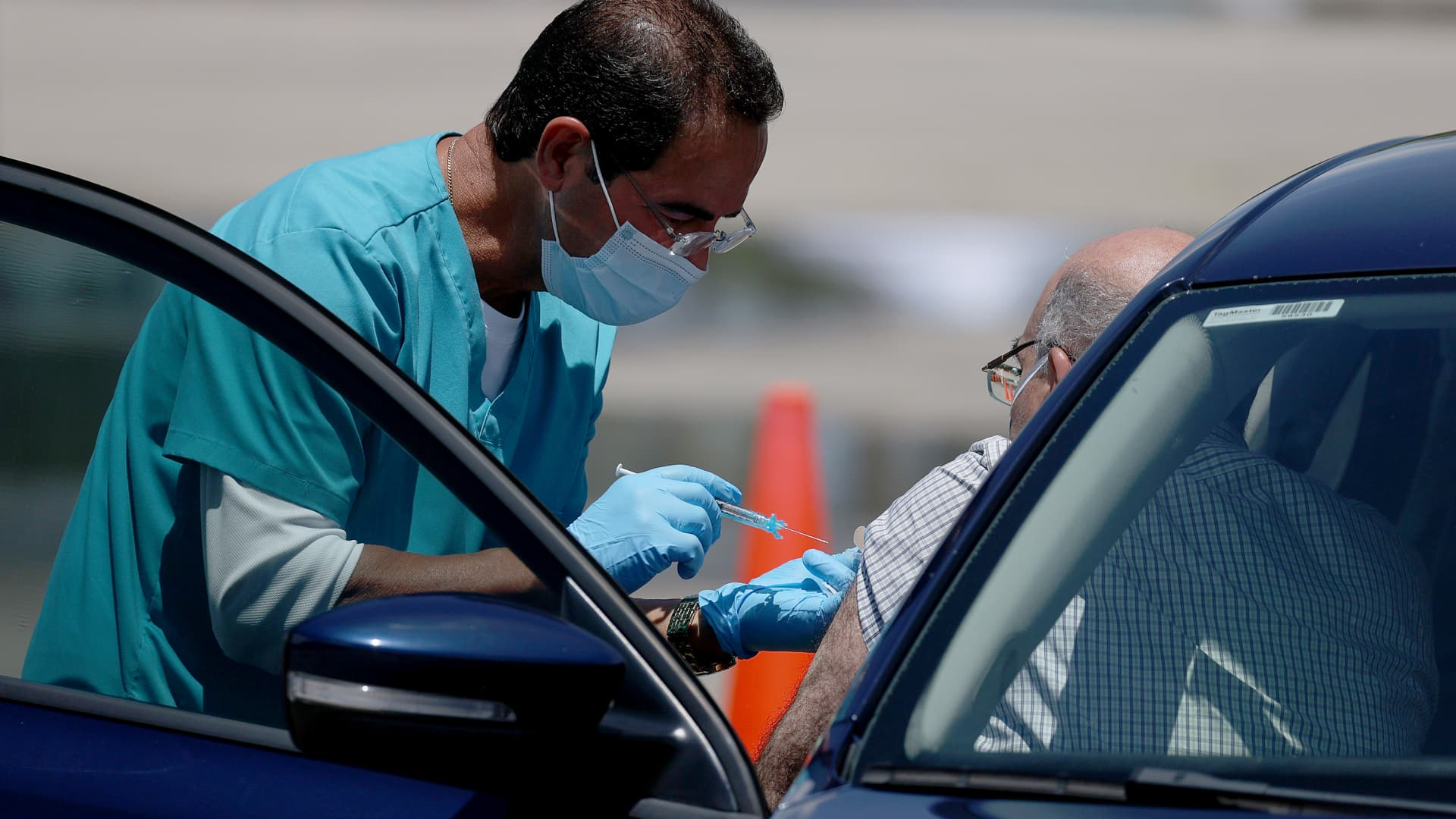 A healthcare worker at a drive-thru site setup by Miami-Dade and Nomi Health in Tropical Park prepares to administer a COVID-19 vaccine on July 26, 2021 in Miami, Florida.