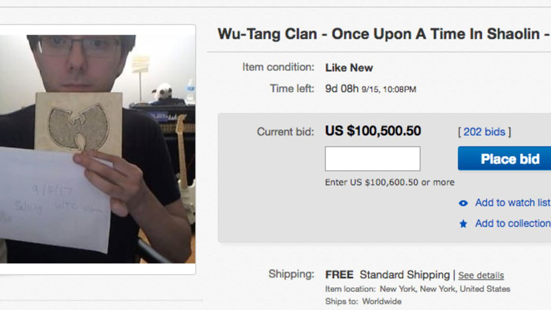 Martin Shkreli holds up a rare Wu-Tang Clan album for sale.
