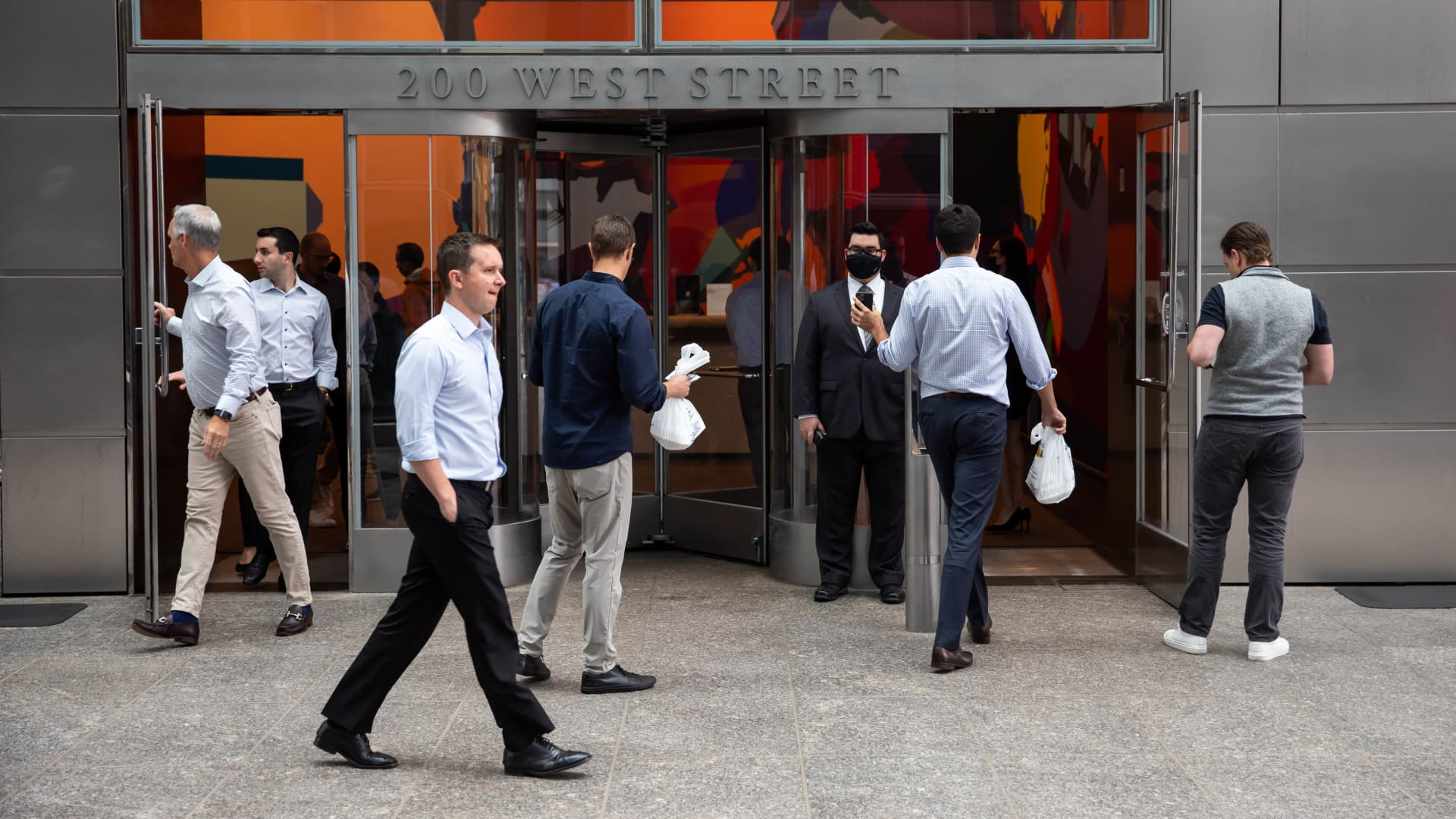 People enter the Goldman Sachs headquarters building in New York, U.S., on Monday, June 14, 2021.