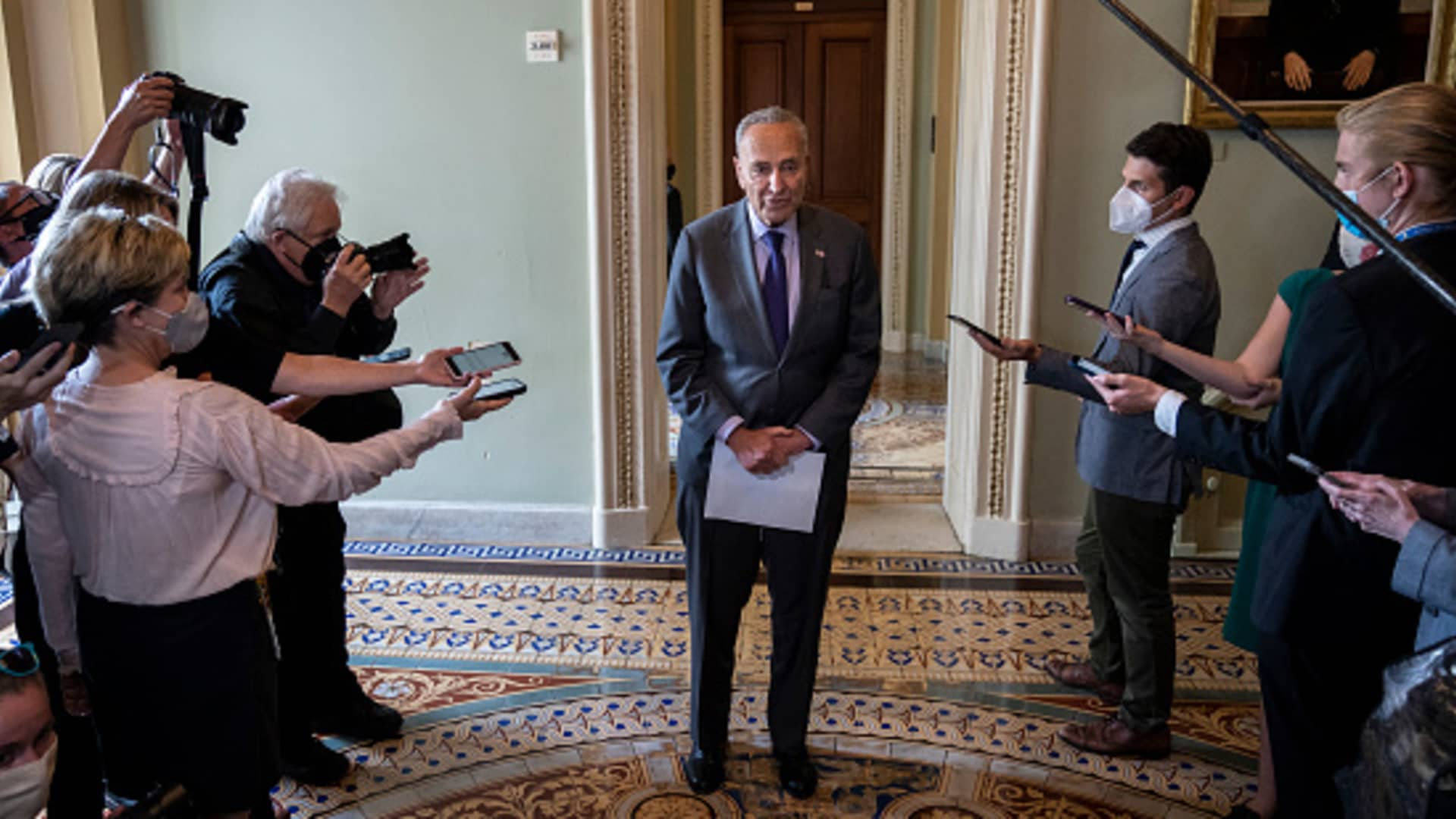 Senate Majority Leader Chuck Schumer (D-NY) speaks briefly to reporters after a meeting with Senate Democrats at the U.S. Capitol on July 28, 2021 in Washington, DC.