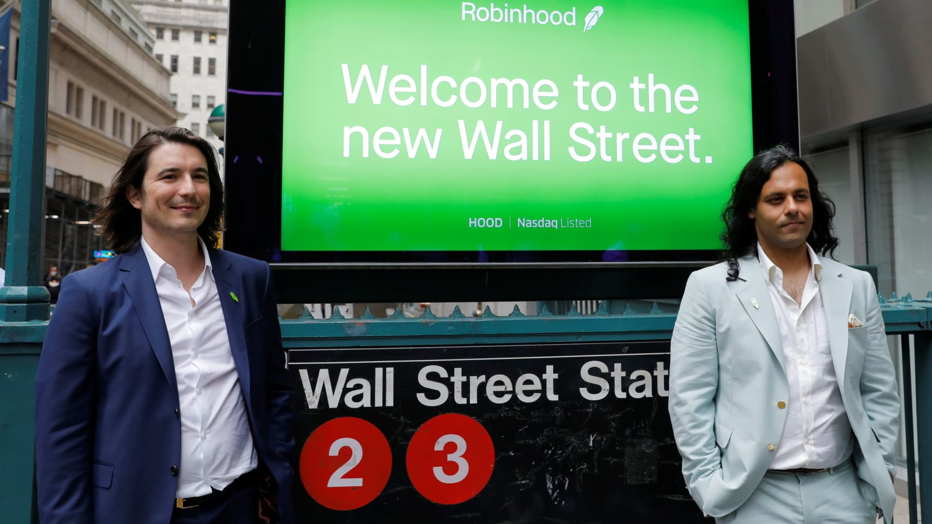 Robinhood Markets, Inc. CEO and co-founder Vlad Tenev and co-founder Baiju Bhatt pose with Robinhood signage on Wall Street after the company's IPO in New York City, U.S., July 29, 2021.