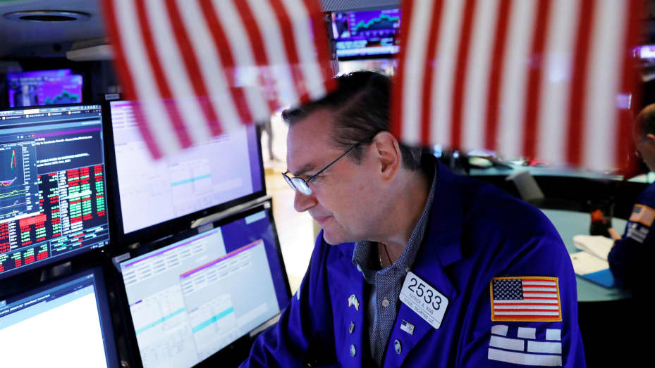 Traders work at the New York Stock Exchange (NYSE) in New York City, August 3, 2021.