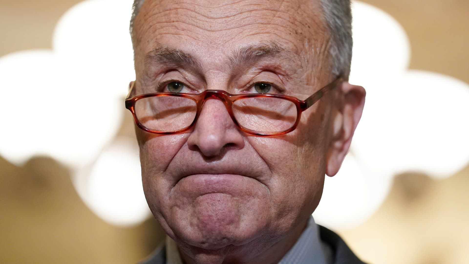U.S. Senate Majority Chuck Schumer (D-NY) looks up after reading a statement calling for the resignation of New York Governor Andrew Cuomo at the U.S. Capitol in Washington, August 3, 2021.