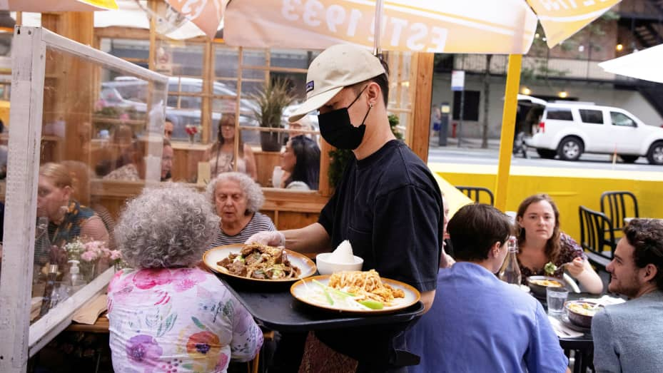 Food is served at an outdoor restaurant in New York, August 3, 2021.