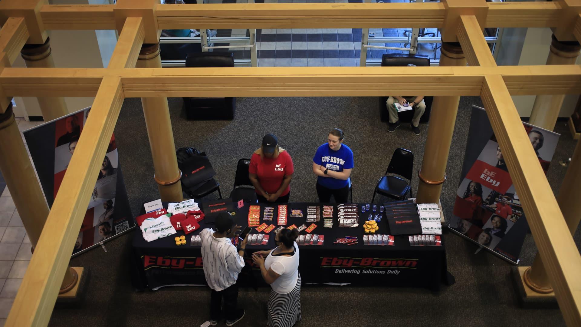 Job seekers speak with recruiters at a Job News USA career fair in Louisville, Kentucky, on June 23, 2021.