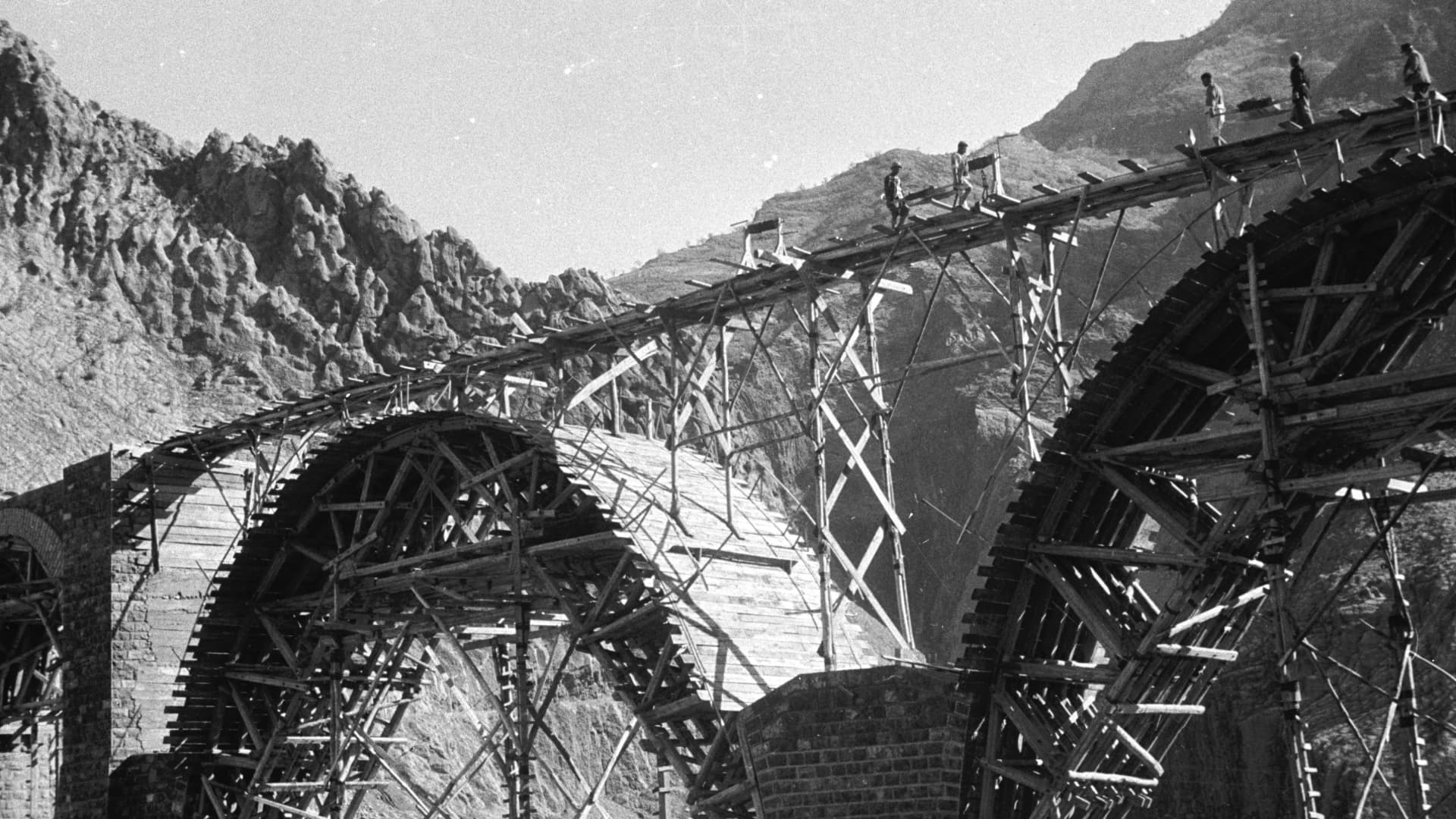 A railway bridge is constructed to form part of the Trans-Iranian Railway in 1956.