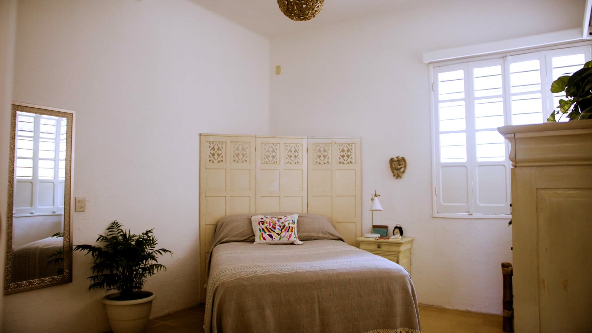 My bedroom is a cozy, peaceful oasis in the back corner of the apartment. The headboard is made from 100-year-old shutters from one of the oldest hotels in Mazatlán.
