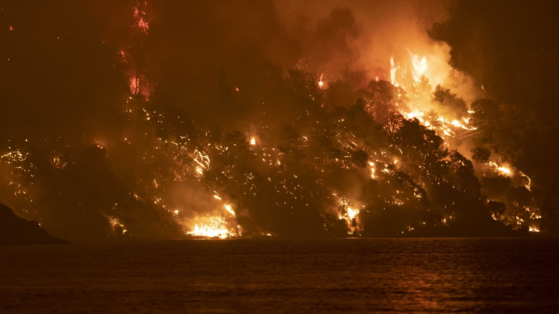 Wildfire approaches the seaside village of Limni, on the island of Evia, Greece, on August 6, 2021.