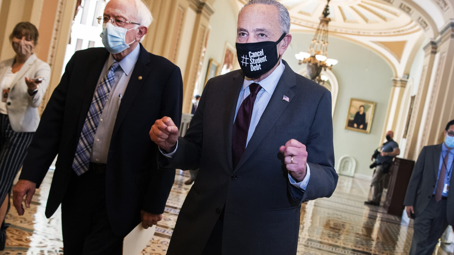 Senate Majority Leader Charles Schumer, D-N.Y., right, and Sen. Bernie Sanders, I-Vt., are seen in the U.S. Capitol on Monday, August 9, 2021.