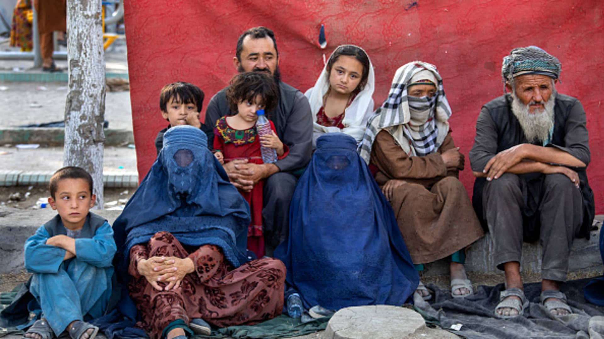 Charyar,70, from the Balkh province sits alongside his family at a makeshift IDP camp in Share-e-Naw park to various mosques and schools on August 12, 2021 in Kabul, Afghanistan.