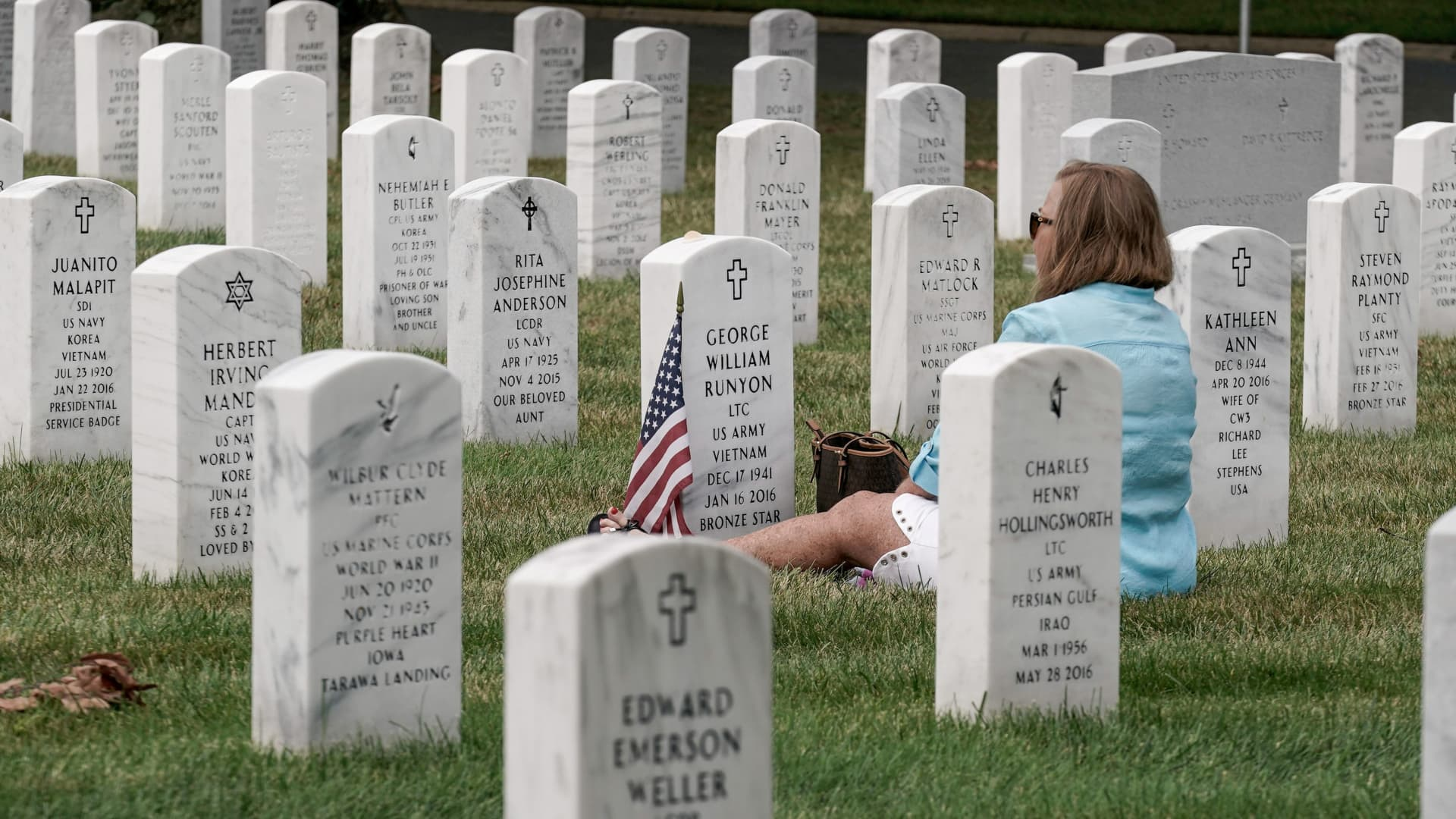 Jan Runyon visits her husband George William Runyon's grave site in Section 60 at Arlington National Cemetery in Arlington, Virginia, U.S., August 15, 2021 on the day Taliban insurgents entered Afghanistan's capital Kabul.