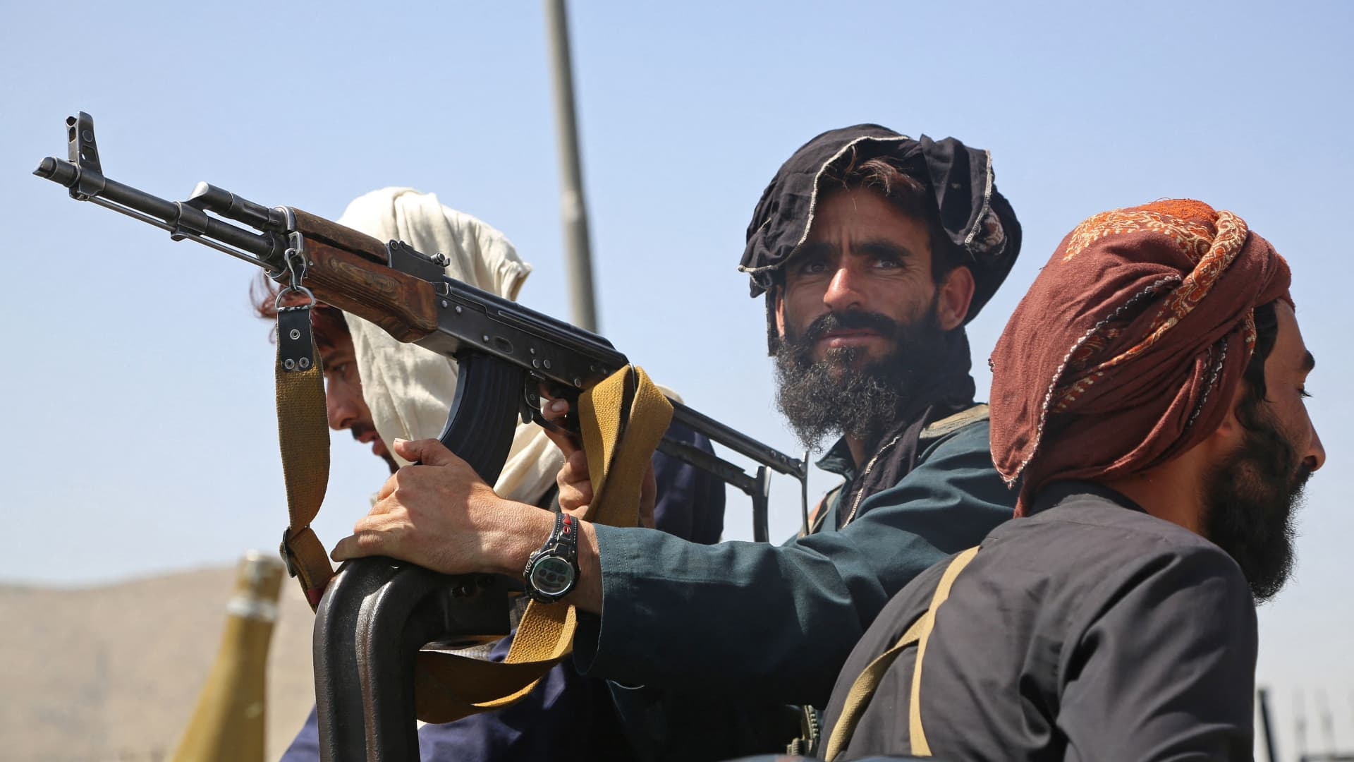 Taliban fighters stand guard in a vehicle along the roadside in Kabul on August 16, 2021, after a stunningly swift end to Afghanistan's 20-year war, as thousands of people mobbed the city's airport trying to flee the group's feared hardline brand of Islamist rule.