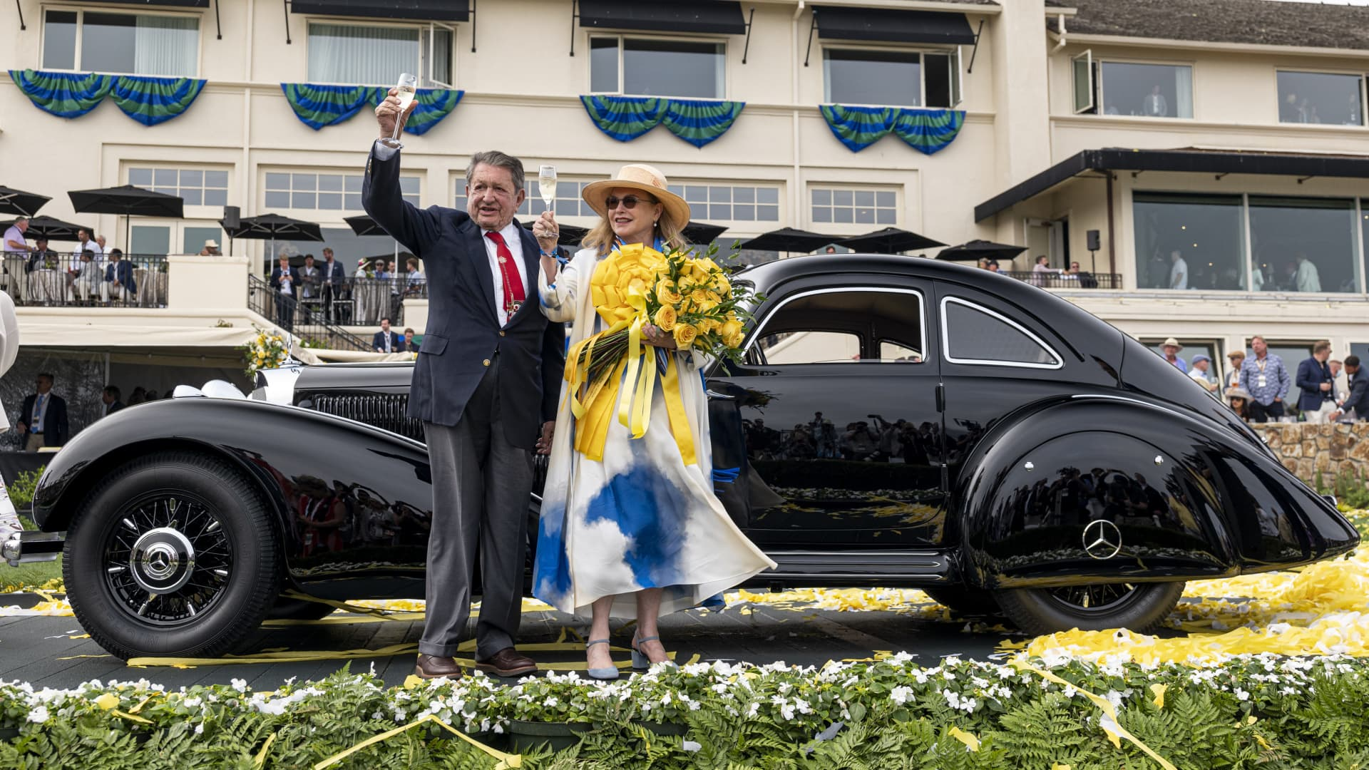 Arturo and Deborah Keller celebrate after winning the Best of Show award with their 1938 Mercedes-Benz 540K Autobahn Kurier at the 2021 Pebble Beach Concours d'Elegance in Pebble Beach, California, U.S., on Sunday, Aug. 15, 2021.