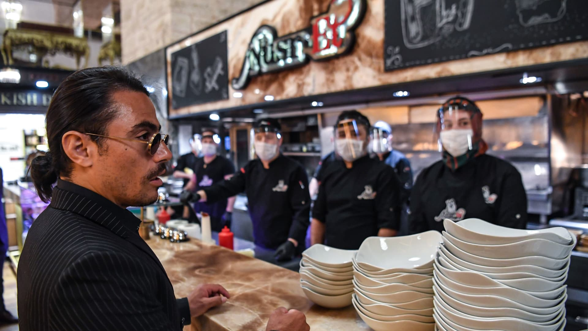 Turkish restaurateur Nusret Gokce, also known as 'Salt Bae', speaks to his staff at his restaurant 'Nusr-Et' at the Grand Bazaar after its reopening on June 1, 2020 in Istanbul.