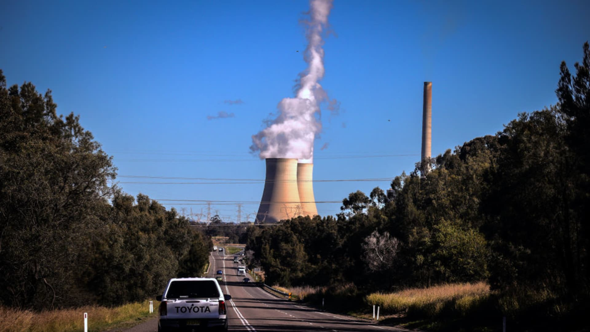 Smoke and steam rises from the Bayswater coal-powered thermal power station located near the central New South Wales town of Muswellbrook, New South Wales, in Australia.