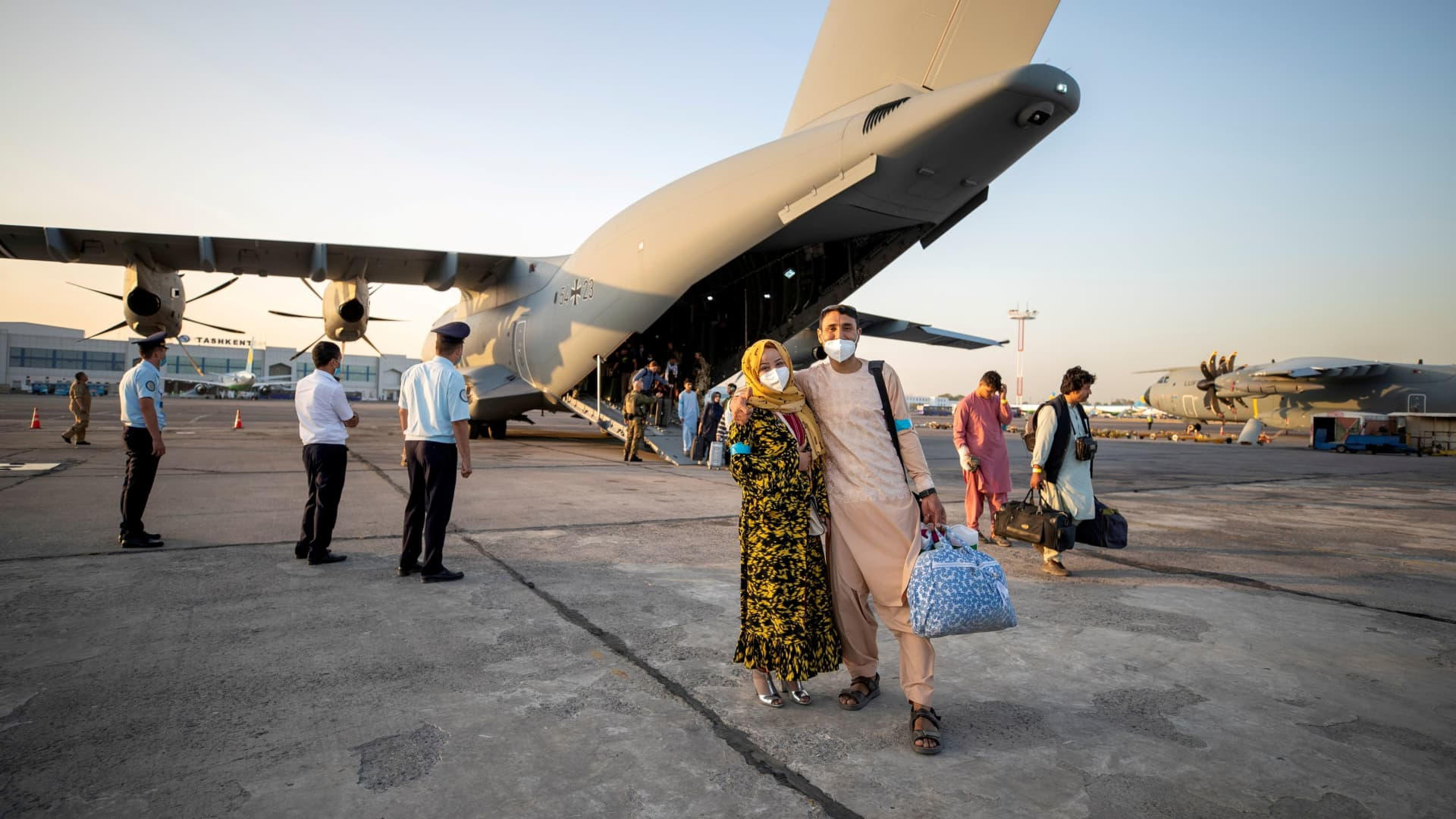 A handout photo obtained from Twitter via @Bw_Einsatz on August 17, 2021 shows evacuees from Afghanistan as they arrive in an Airbus A400 transport aircraft of the German Air Force Luftwaffe in Tashkent, Uzbekistan.